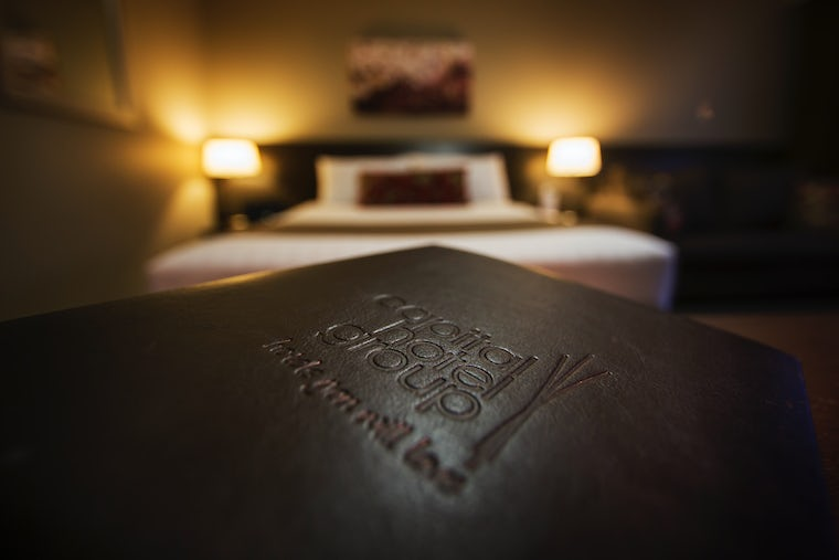 A picture of an accommodation guide at the capital hotel group in canberra
