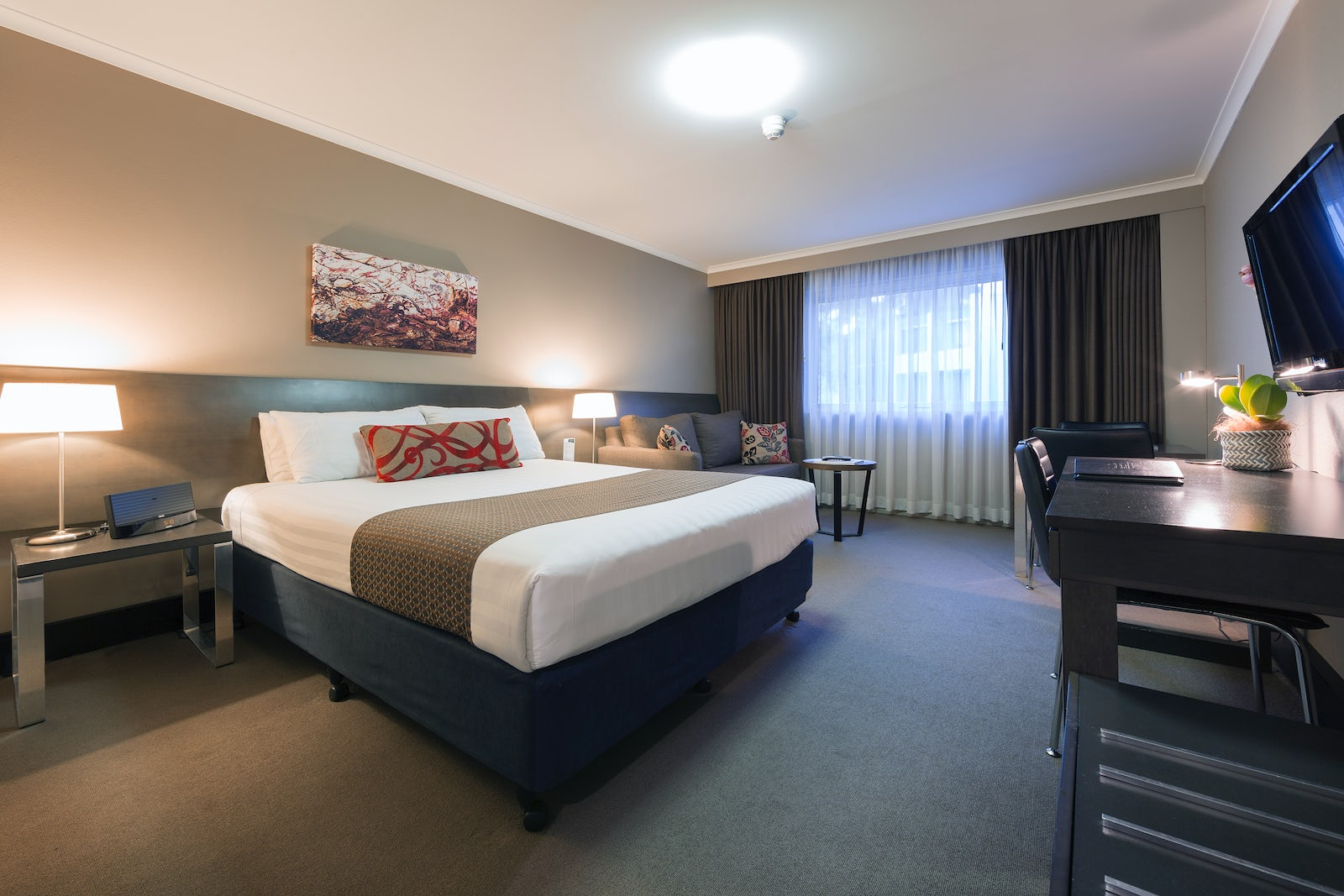 A bedroom in the hotel Pavilion on Northbourne, located in Canberra