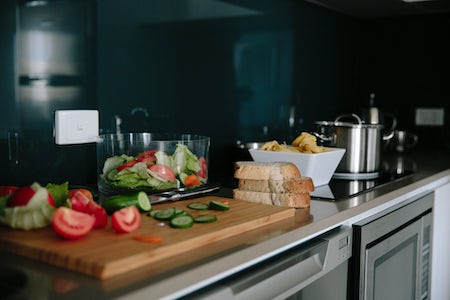 A picture of food preparation in the apartment kitchen at Aria Hotel on Dooring Street