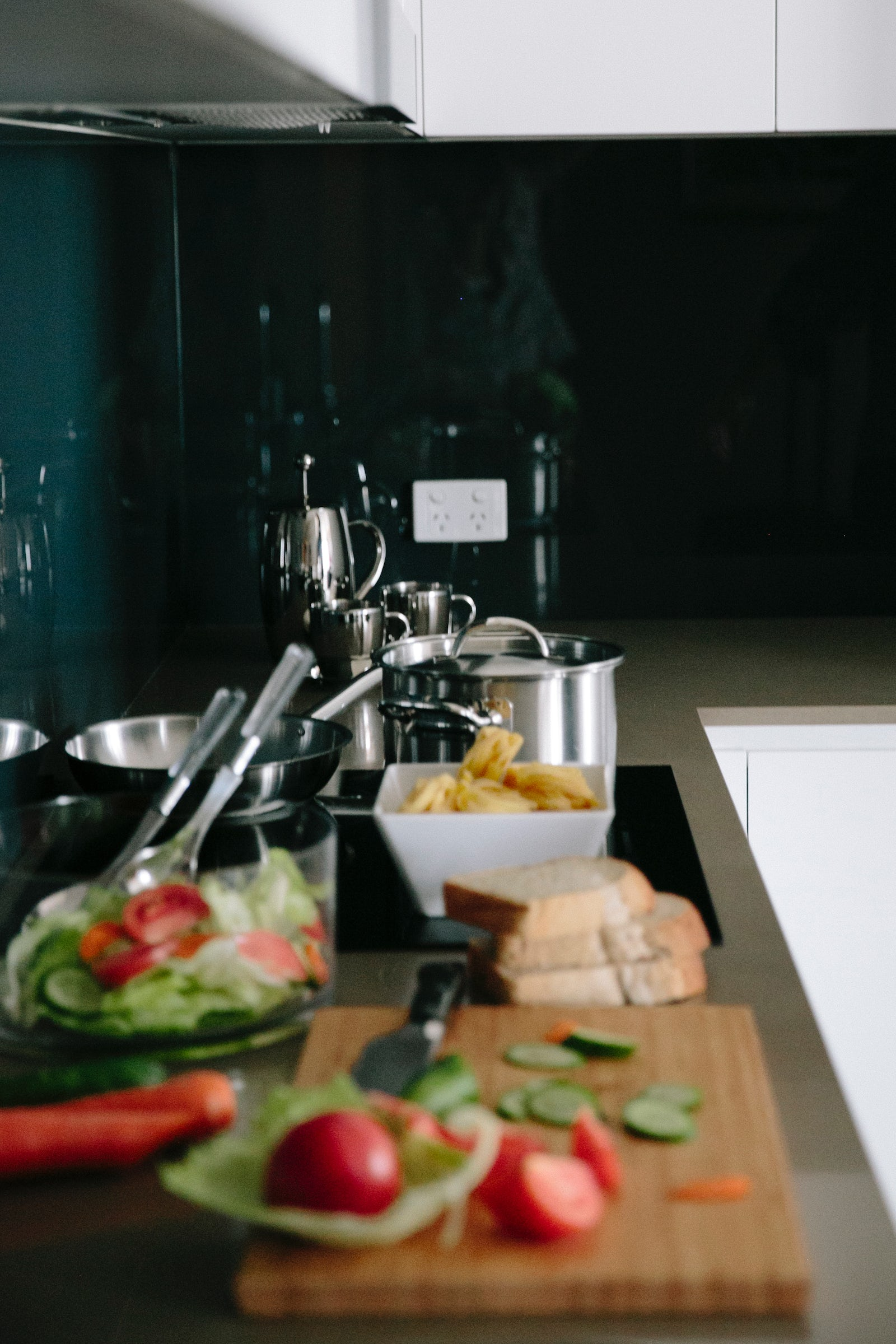 An image of food being prepared in the kitchen of Aria Hotel family apartments in Canberra CBD