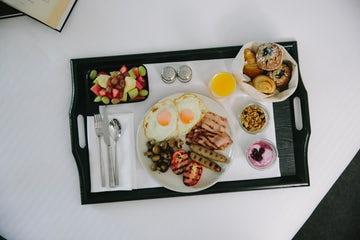 A picture of an English breakfast room service at Avenue Hotel on Northbourne Avenue