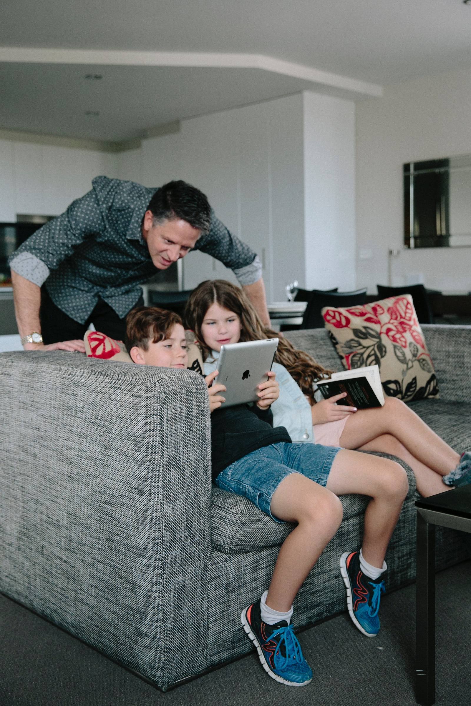 An image of a family sitting in the lounge room at the Aria Hotel in Dickson