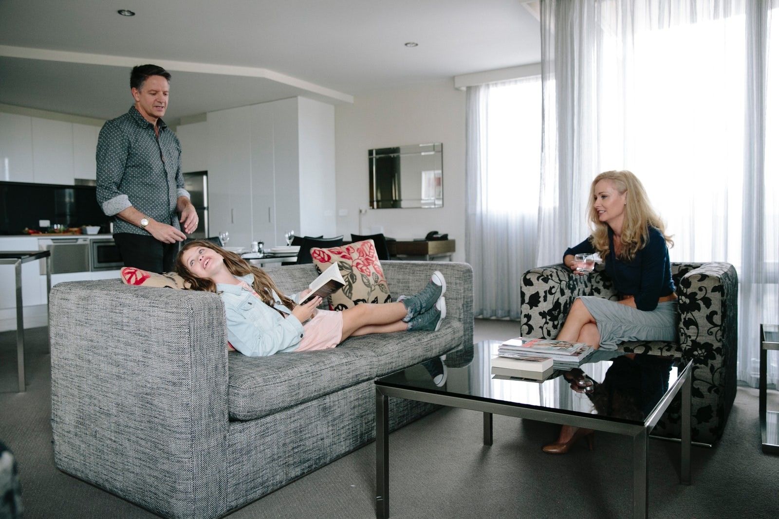 An image of a family spending time together in the Aria Hotel apartments on Dooring Street