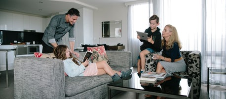 An image of a family staying at Aria Hotel in the family apartment in Dickson