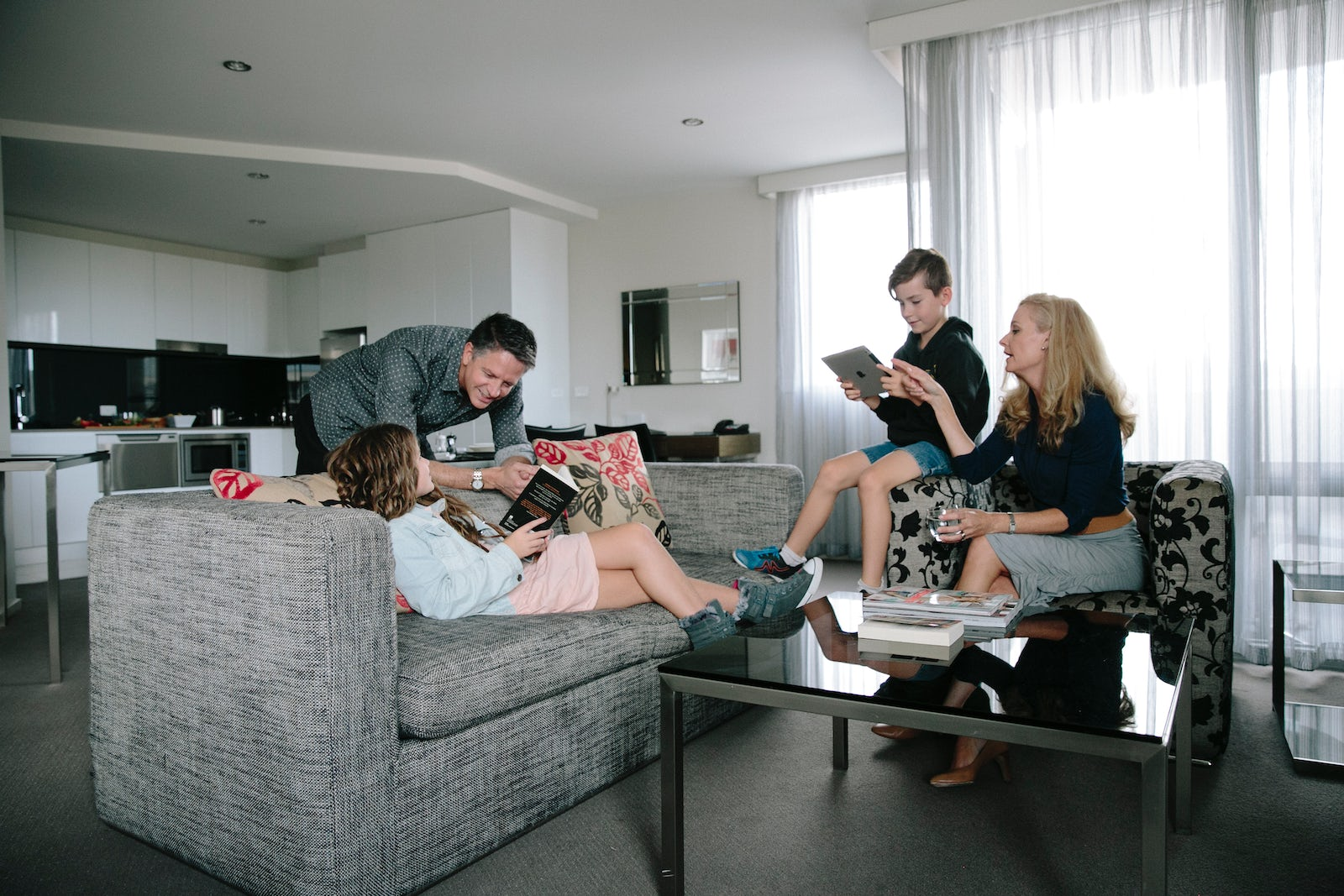 A picture of a family staying in a four bedroom apartment at Aria Hotel in Dickson