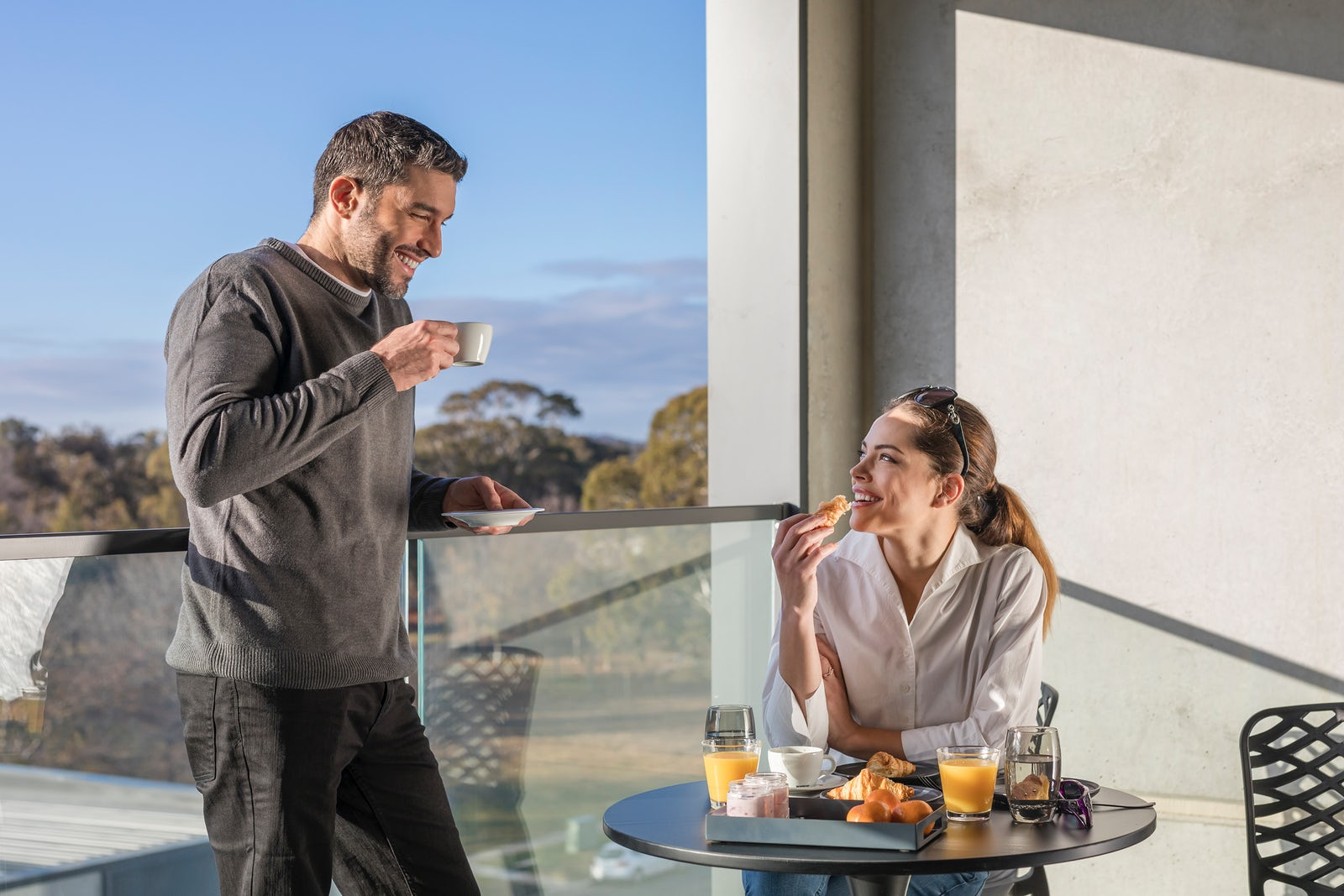 Couple enjoying coffee at the Deco Hotel Canberra