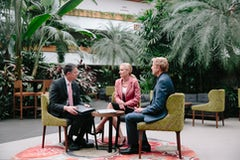 A picture of a meeting in a hotel foyer of the capital hotel group canberra
