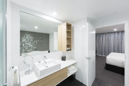 A picture of a modern apartment bathroom at the Avenue on Northbourne Avenue