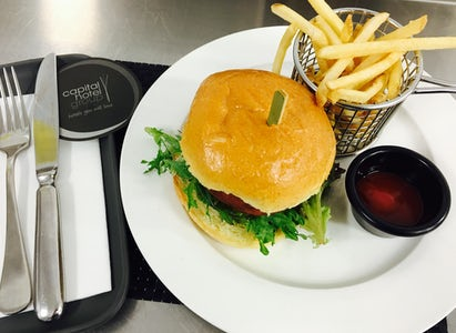 Image of a burger and chips served at the restaurant at the Avenue Hotel on Northbourne Avenue
