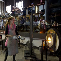 Lady learning glass blowing at Glassworks Canberra