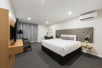 An image a stylish modern hotel room located in the Avenue Hotel in Braddon