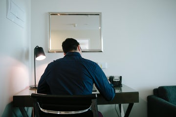 A picture of a man working at a desk in the Avenue Hotel located in Braddon