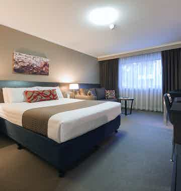 Picture of a bedroom in the Aria Hotel which is located on Dooring street