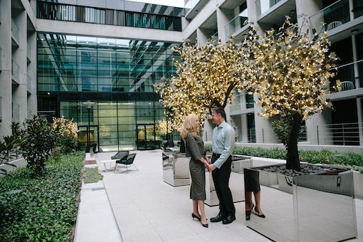 A picture of a couple enjoying the outdoors at the Avenue Hotel on Northbourne Avenue