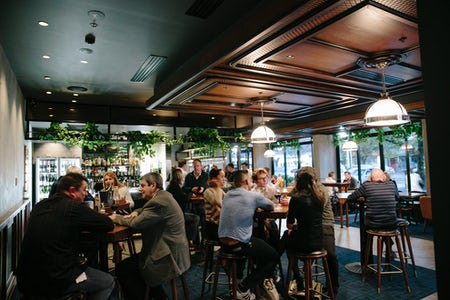 An image of people enjoying a drink at Marble and Grain at the Avenue Hotel in Canberra