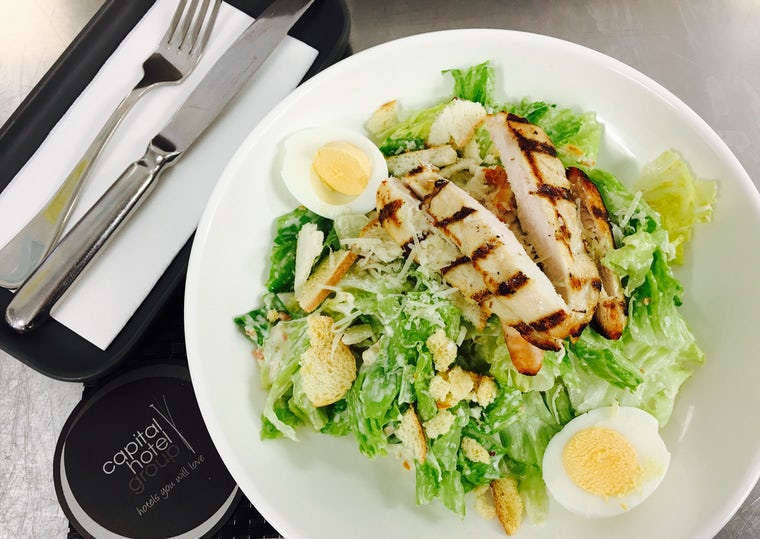 A picture of a Caesar Salad made in the restaurant at Aria Hotel Canberra