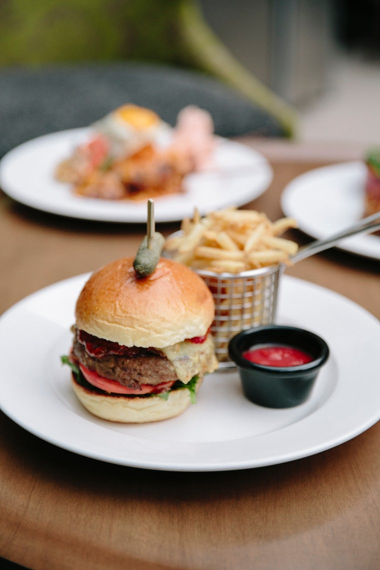 A picture of burger and chips at the restaurant at Pavilion on Northbourne Hotel in Canberra