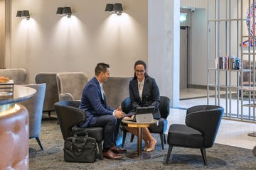 Two people having a business meeting at the Deco Hotel