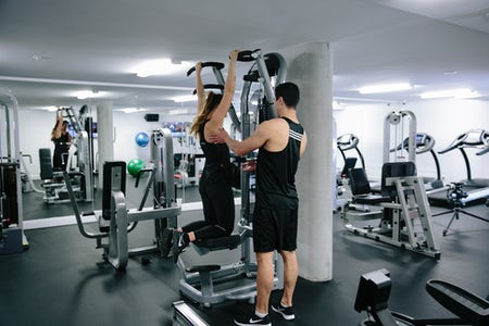 A picture of a woman working out in a gym at the Avenue Hotel in Canberra