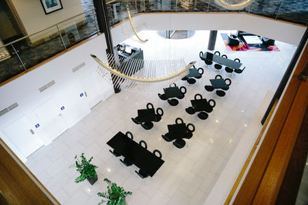 An image of tables in the foyer at Aria Hotel Canberra